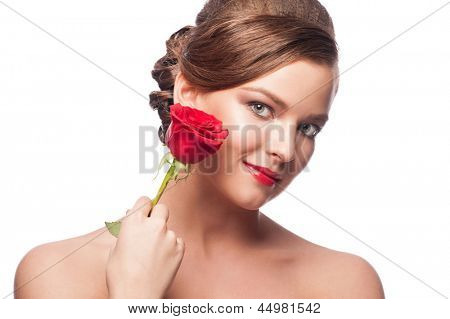 Portrait of elegant beautiful woman with red lipstick holding red rose. Isolated on white background