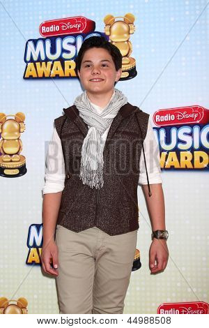 LOS ANGELES - APR 27:  Zach Callison arrives at the Radio Disney Music Awards 2013 at the Nokia Theater on April 27, 2013 in Los Angeles, CA
