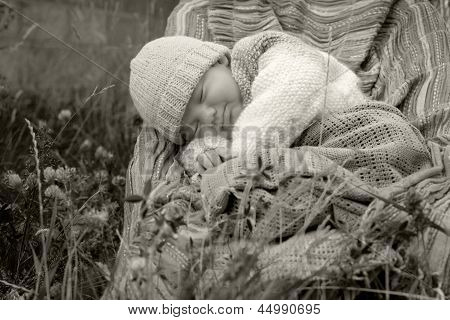 Baby Boy In Knitted Jacket