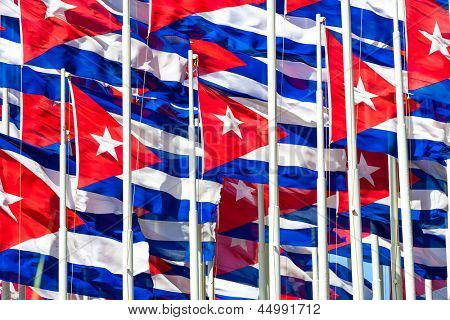 Compact group of cuban flags useful to illustrate subjects related to the cuban revolution, politics or communism