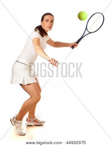 Adult woman playing tennis. Studio shot over white.
