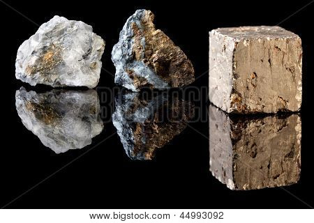 Chalcopyrite and pyrite in uncut rough state, two minerals often confused with gold.  Pyrite is therefore called Fool's Gold