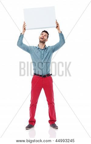 Happy man holding a blank sign overhead