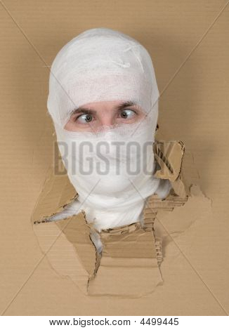 Male Face On Bandage In Carton Hole