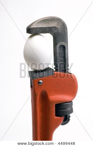 Pipe Wrench With An Egg In It's Jaws
