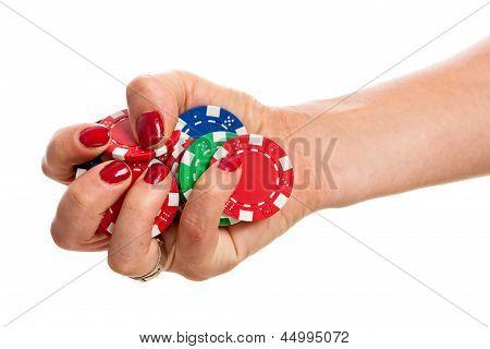 Hand Holding Poker Chips