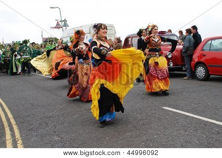 HASTINGS, ENGLAND - MAY 7: Dancers perform during a parade on the West Hill at the annual Jack In The Green festival on May 7, 2012 in Hastings, East Sussex. The event marks the UK May Day holiday.