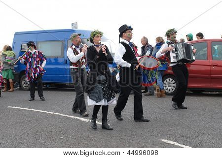 HASTINGS, ENGLAND - MAY 7: The Miscellany Dance Group take part in a parade on the West Hill at the annual, May Day, Jack In The Green festival on May 7, 2012 in Hastings, East Sussex.