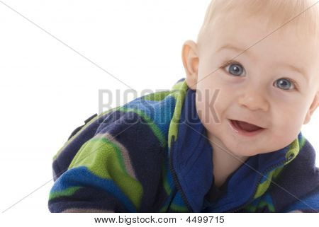 Smiling Teething Baby Boy Crawls Toward Camera