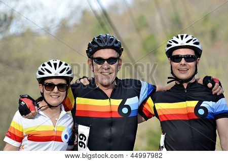 Three Smiling Cyclists