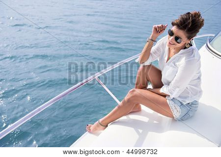 Woman sailing in a yacht on her summer holidays