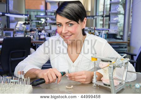 Dental Technician In A Laboratory Smiling At Work