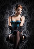 stock photo of corset  - Beautiful and sexy cabaret artist in lingerie over vintage background - JPG