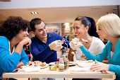 stock photo of lunch  - Happy teenagers having fun while lunch at restaurant - JPG