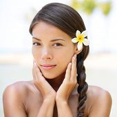 Spa resort beauty portrait of woman looking at camera serene outside. Beautiful skin care concept wi