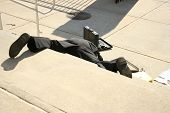 pic of adversity humor  - Shot of a man falling down steps outside a building - JPG