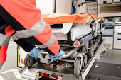 picture of stretcher  - Paramedic taking out stretcher from ambulance car - JPG