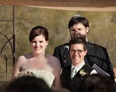 picture of rabbi  - Happy women with rabbi in civil union ceremony - JPG