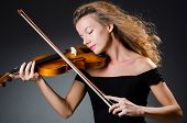 stock photo of cello  - Attractive woman with cello in studio - JPG