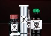 picture of vicious  - Deadly poison in bottles on black background - JPG
