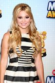 LOS ANGELES - APR 27:  Olivia Holt arrives at the Radio Disney Music Awards 2013 at the Nokia Theate