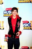 LOS ANGELES - APR 27:  Austin Mahone arrives at the Radio Disney Music Awards 2013 at the Nokia Thea