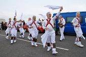 HASTINGS, ENGLAND - MAY 7: Morris dancers perform during a parade on the West Hill at the annual, Ma