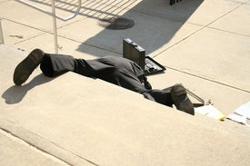 image of adversity humor  - Shot of a man falling down steps outside a building - JPG