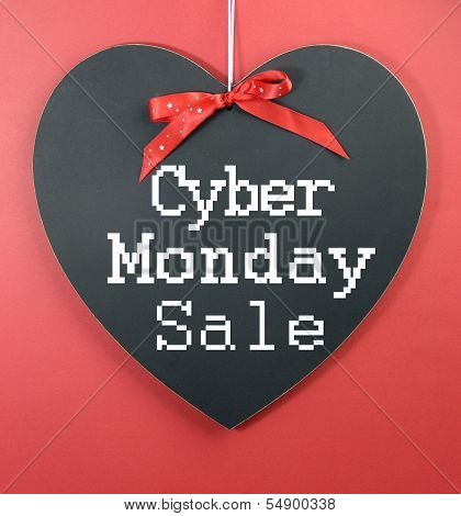 Cyber Monday Online Christmas Shopping Sale Concept With Greeting On Heart Shape Blackboard Against