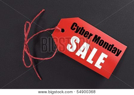 Cyber Monday Online Christmas Shopping Sale Concept With Text On Red Ticket Against A Black Backgrou