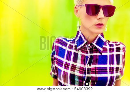 Stylish country girl on a bright yellow background