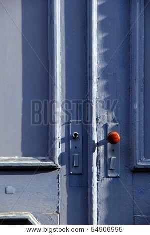 Bright blue doors in shadow