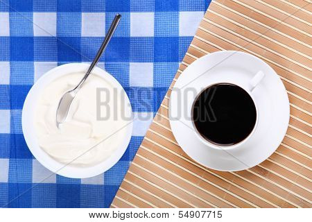 Continental breakfast with a cup of black coffee