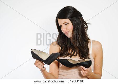 Beautiful Woman Deciding Between Two Shoes