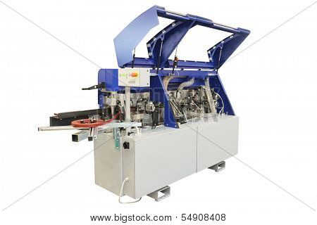 industrial machine for sticking on adhesive tape
