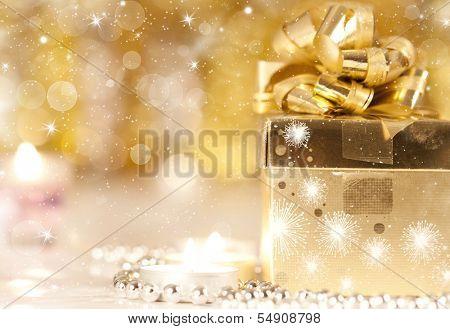 Gift box, candles and Christmas lights