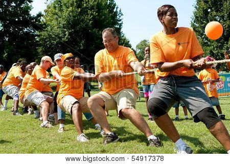 Team Pulls Rope In Adult Tug-of-war Competition