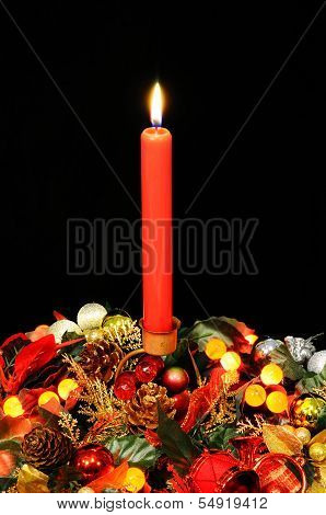 Red candle in Christmas holder.