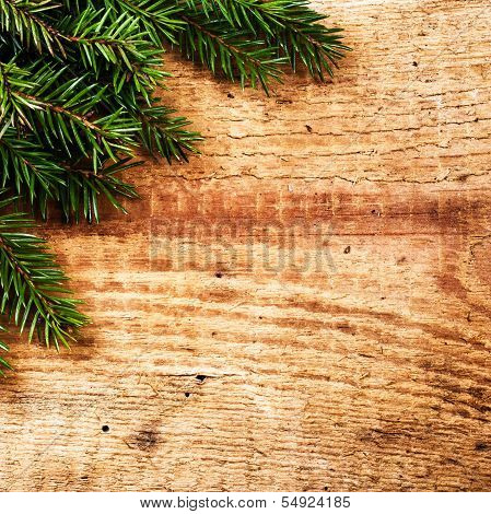 Christmas Background With Fir Tree Branch On Wooden Background With Copy Space For Greeting Text. Vi