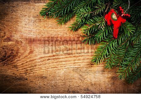 Christmas Ornaments On Vintage Wooden Background. Christmas Frame With Fir Tree Branches And  Red Ch