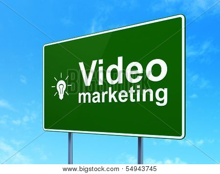 Finance concept: Video Marketing and Light Bulb on road sign background