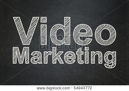 Finance concept: Video Marketing on chalkboard background