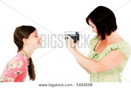 Woman Filming Girl