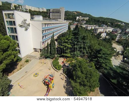 YALTA - AUG 23: View from unmanned quadrocopter on territory of sanatorium Yasnaya Polyana with children playground on August 23, 2013 in Yalta, Ukraine.