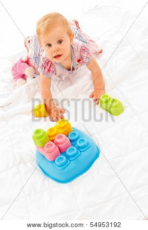 Little Girl Playing With Building Blocks