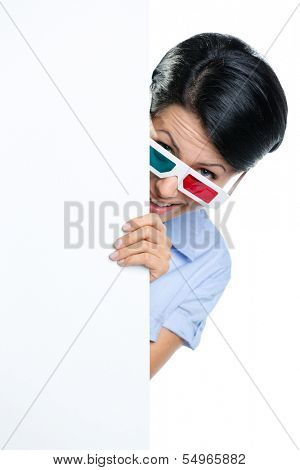 Viewer in 3D glasses peeps out from behind the copyspace, isolated on white