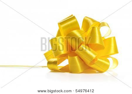 Festive yellow bow on white background