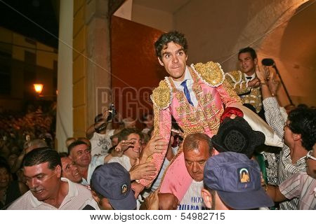 Spanish Bullfighter Jose Tomas going out to shoulders for the big door after one having big bullfig