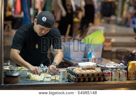 Thai chef preparing street food