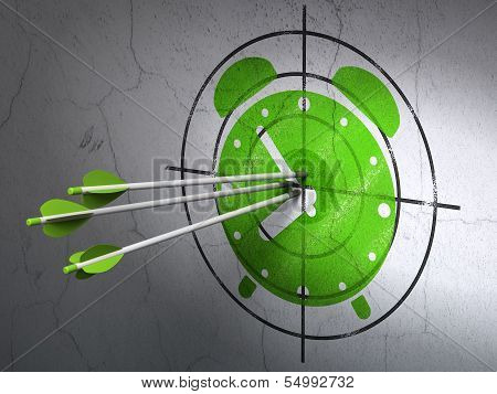 Time concept: arrows in Alarm Clock target on wall background